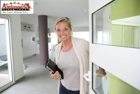 Real Estate Agent Opens Door