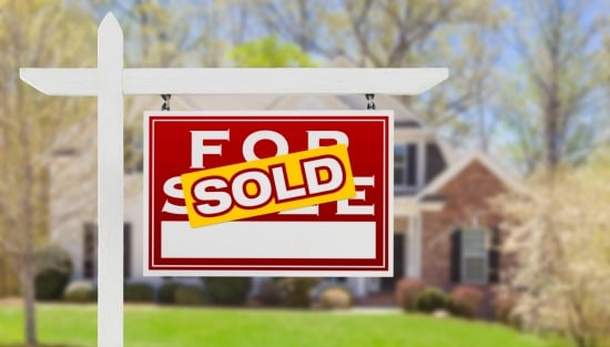 for sale sign with sold sticker